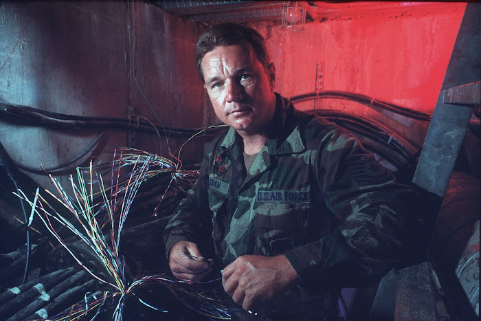 TSgt Edward Shaw in underground cable vault.