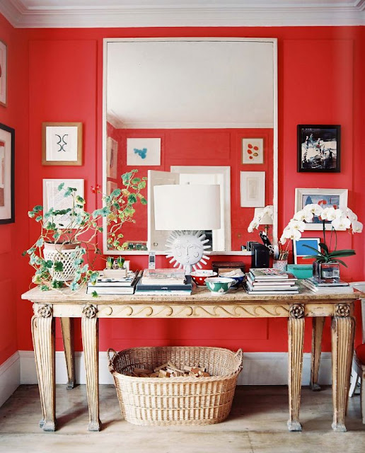 Red foyer with natural accents and texture