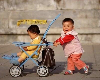 kid-pushing-other-kids-in-rikshaw