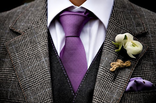 groom with purple tie and vintage vest
