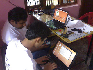 Praveen, Sajjad working on laptops