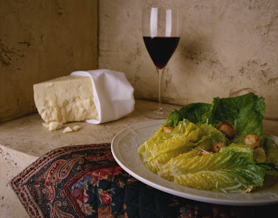 Serene Picture of a Glass of Red Wine and Salad in an Italian setting