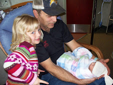 Dad holding Rachel and Jen showing her off