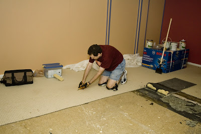 I'm cutting strips of carpet to pull up in the basement--tedious work!