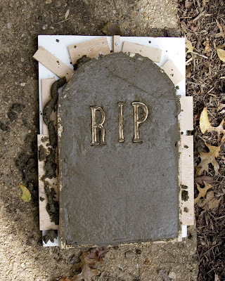 The tombstone mold filled with concrete.