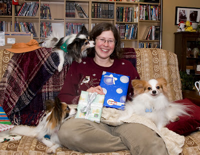 Beth holds up her presents for inspection