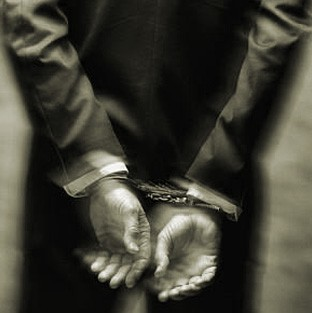 [whitecollar+handcuffs+black+and+white.jpg]