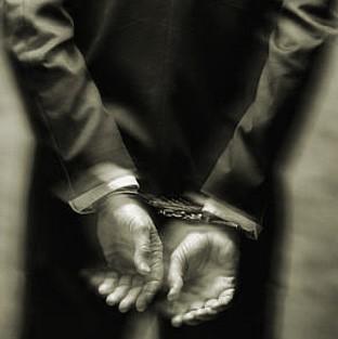 [whitecollar+handcuffs+black+and+white.jpg]