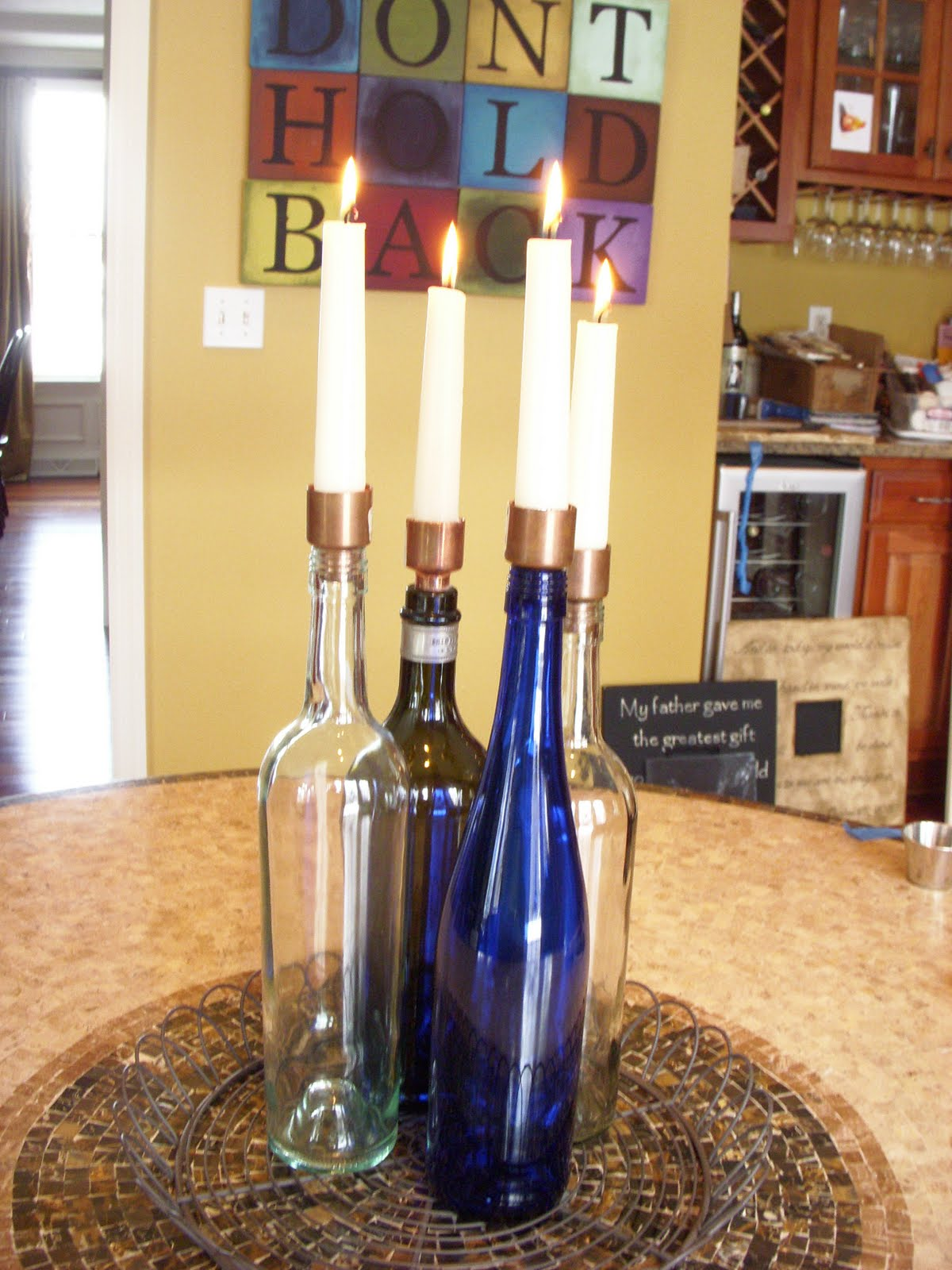 Hope studios wine bottle candle holders for Champagne bottle candle holders