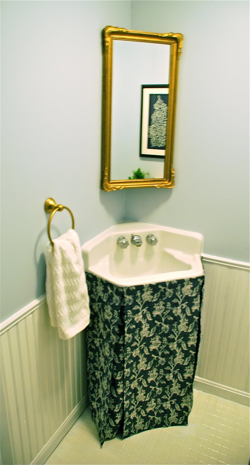 a thousand laughing starfish diy skirted sink tutorial