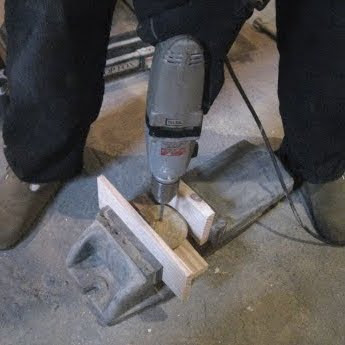 drilling a hole in a stone