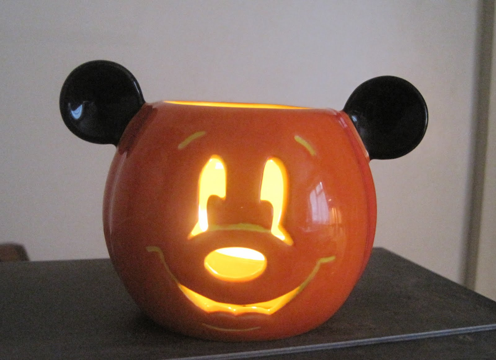 im not a big disney fan but i love the disneyhalloween decorations they come up with and this candle holder is so cute