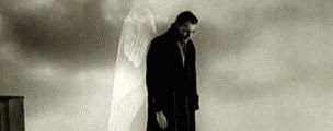 Black and white still of Bruno Ganz as the angel Damiel in Wenders' film 'Wings of Desire'.