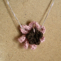 pink and purple crocheted flower pendant necklace