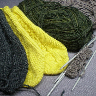 knitted slippers in yellow and dark grey or gray