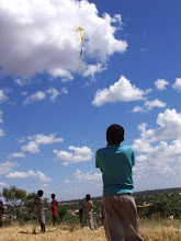 Boy fly kite in Lusaka