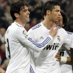 Kaka and Cristiano celebrate the first goal against Real Sociedad