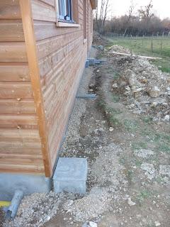 notre maison en bois luant drainage regards et coffrage du mur. Black Bedroom Furniture Sets. Home Design Ideas