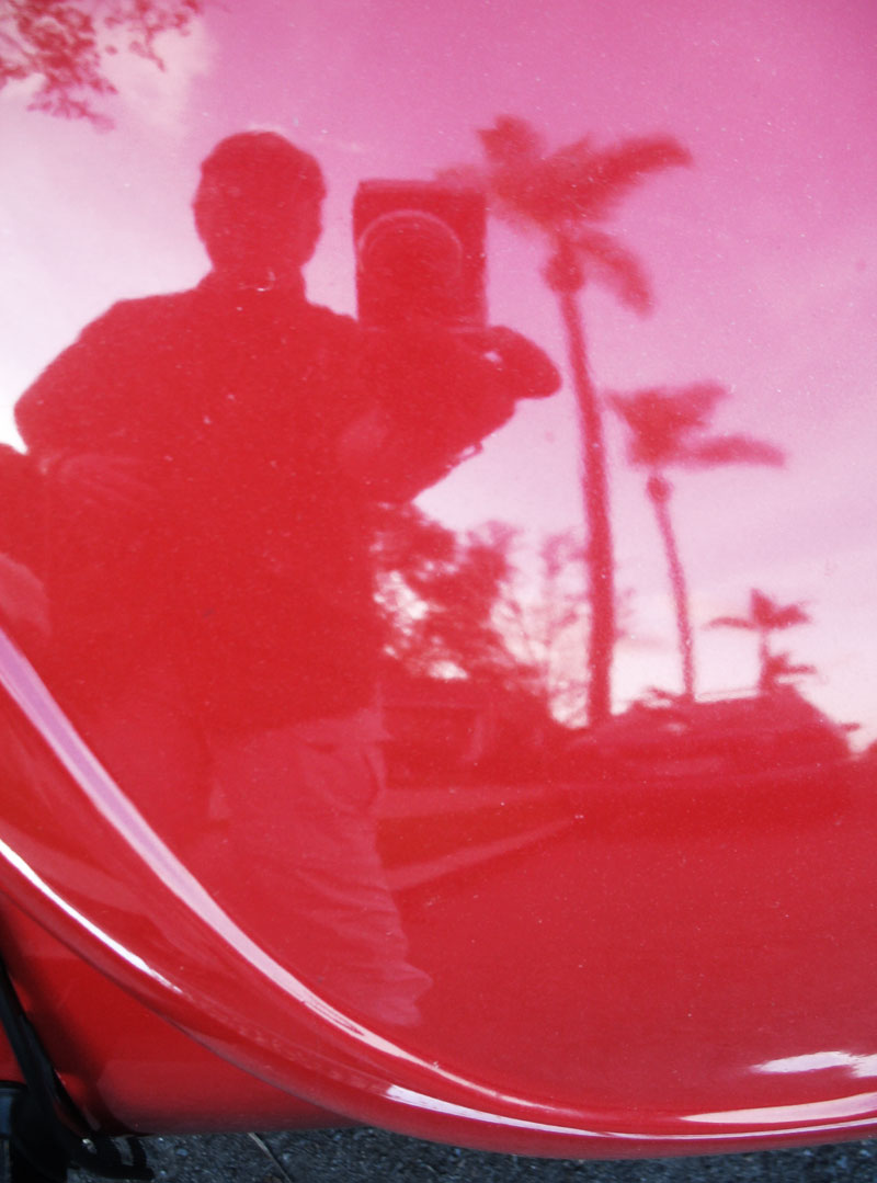 Reflected in the hood of a VW Beetle; click for previous post
