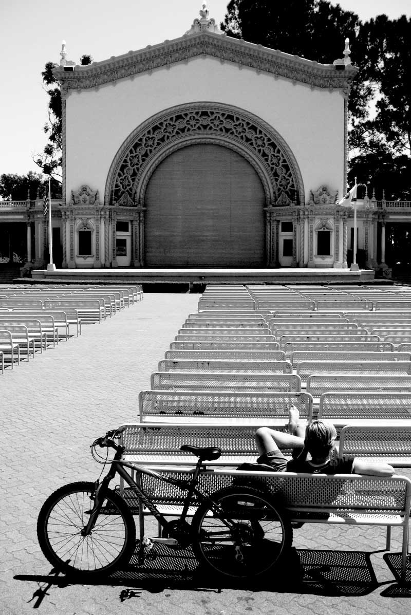 taking a break from his bike; click for previous post