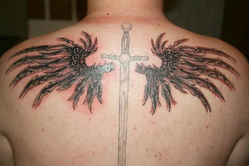 Memorial Cross Tattoo With Angel Wings On Back