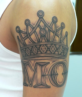crown tattoo with word tattoo design on foot mens tattoos