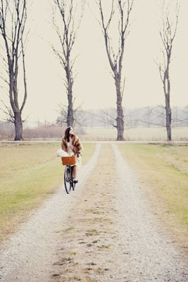 girl on bike in forest