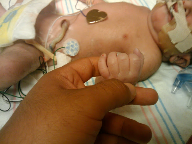 Joshua holding my finger (11-9-09)
