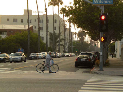 Taking His BIke For A Walk At Dusk - Santa Monica