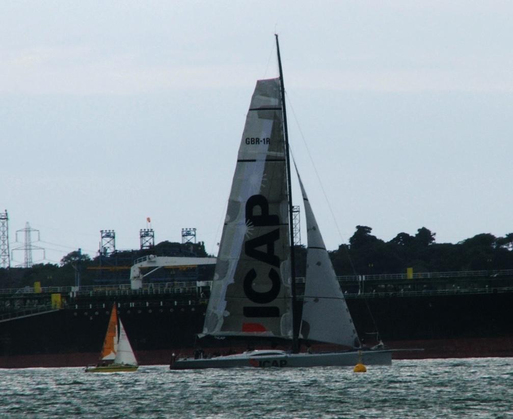 Super MAXI yacht iCAP Leopard overhauls a more modest cruising yacht going ...
