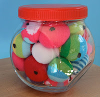 sock snake eyeballs in jar