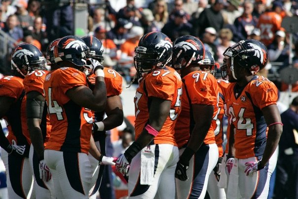 The Denver Broncos defense huddles during a game against the Dallas Cowboys on October 4th 2009. (Photo Paul Cloud)