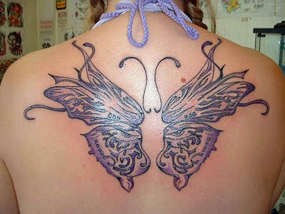 This beautiful butterfly tattoo design on the back of this woman.