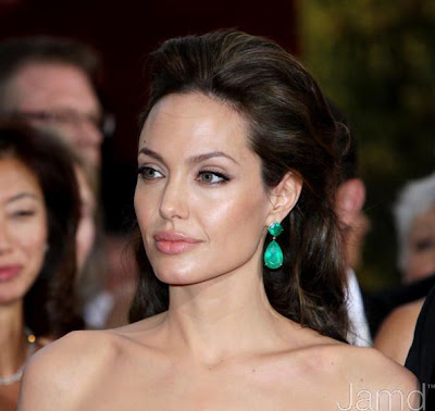 Angelina Jolie in Elie Saab.. Homegirl had on a 65-carat emerald ring & get