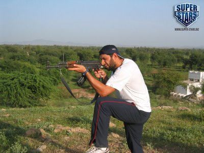 Unseen Shahid Afridi Real Life Photos, Trying Hand on AK 47