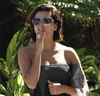 Eva Longoria puffs while in a strapless dress