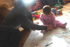 Korey drawing with Savannah - who loves to have her hand traced