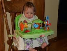 Her new booster seat at Grandma Linda's