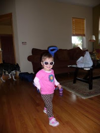 Practicing for a catwalk...she's so Hollywood with her glasses!