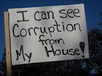 Anti-Palin protest sign: I can see corruption from my house.