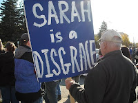 Anti-Palin protest sign: Sarah is a disgrace