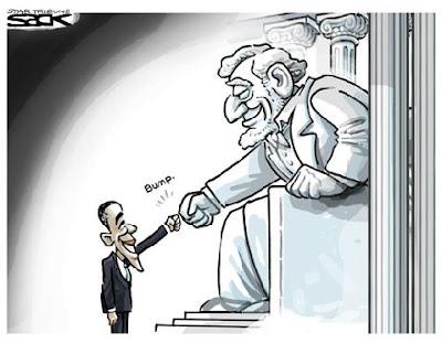 Obama does the fist bump (known on Faux News as the 'terrorist fist jab') with the smiling statue of Abraham Lincoln.