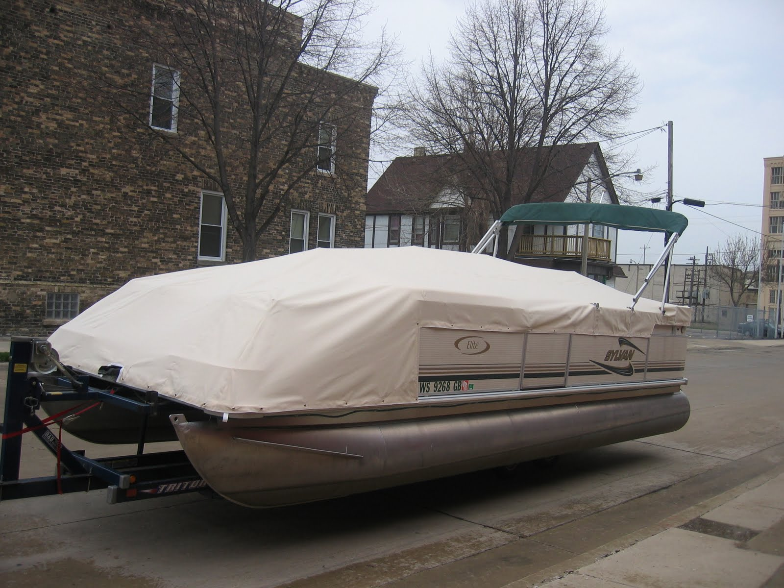 Homestyle Custom Upholstery and Awning: White Pontoon Cover
