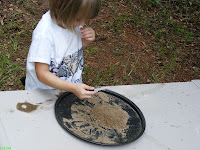 Lana is carefully gold panning