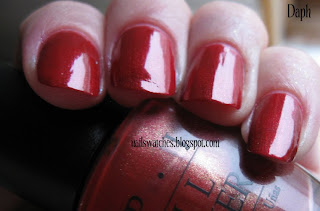 opi vould you like a lick-tenstein red nail polish shimmer gold nailswatches