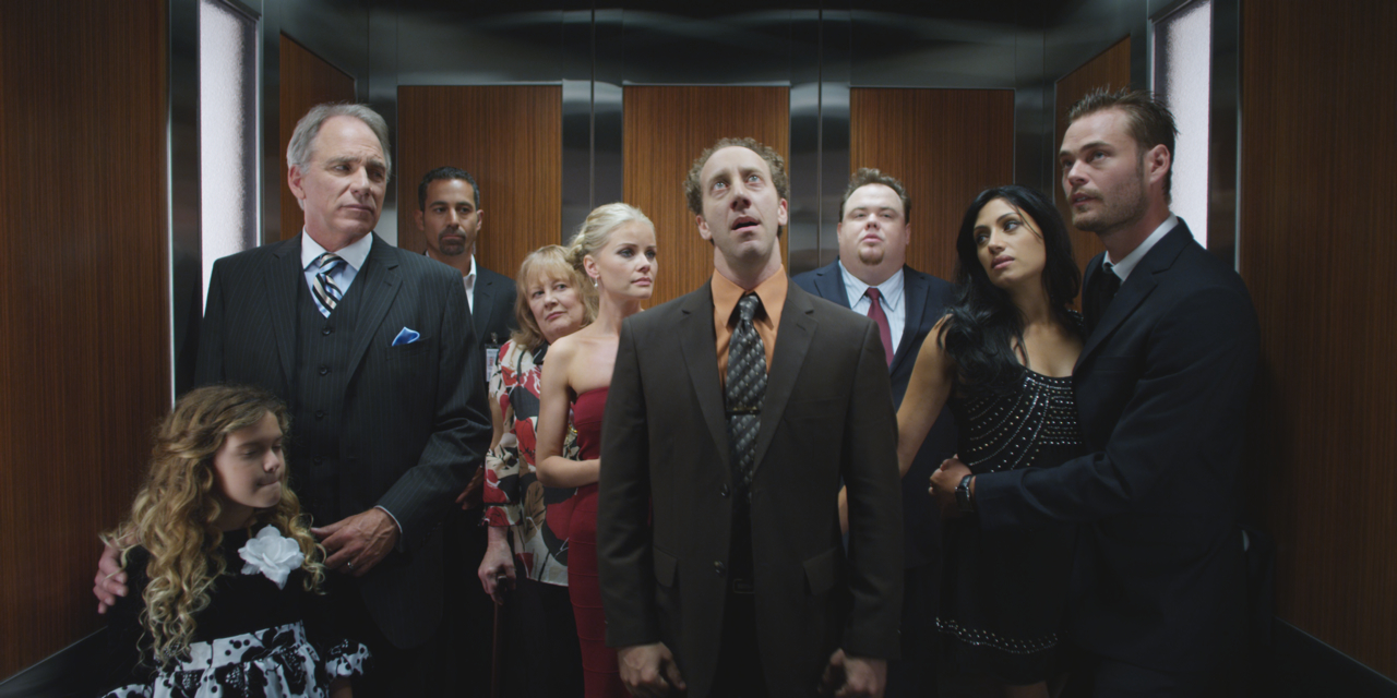people talking in elevator. a set visit with the cast and crew of elevator people talking in l