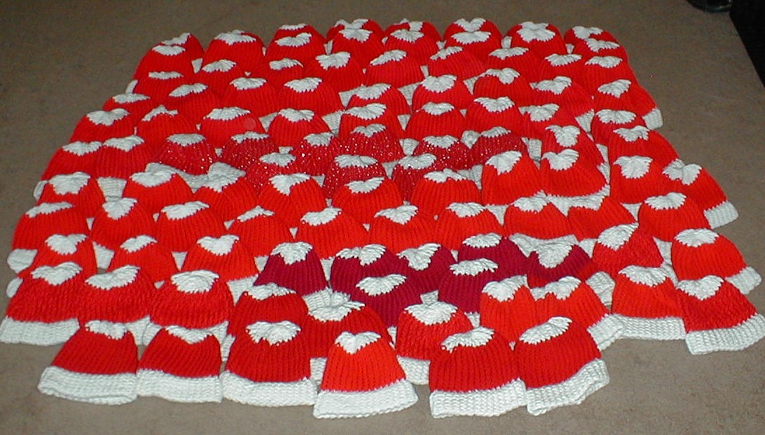 Karens Crocheted Garden of Colors: 104 Loom Knitted Baby Christmas Hats
