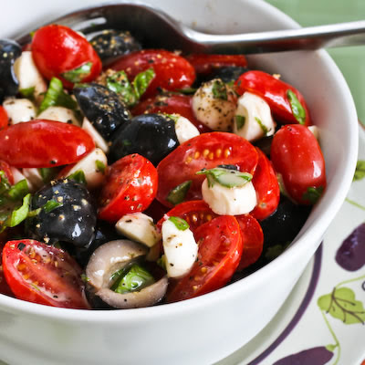 Recipe for Tomato, Olive, and Fresh Mozzarella Salad with Basil Vinaigrette from KalynsKitchen.com