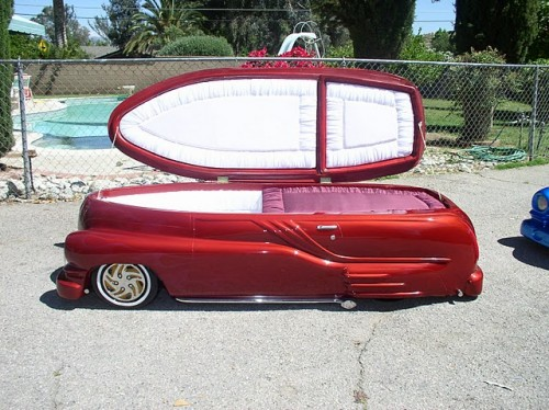Dead People In Caskets http://stuffdeadpeoplelike.blogspot.com/2011/01/hot-rod-caskets.html