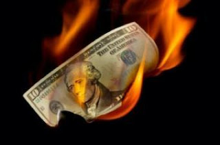 obama burning dollar
